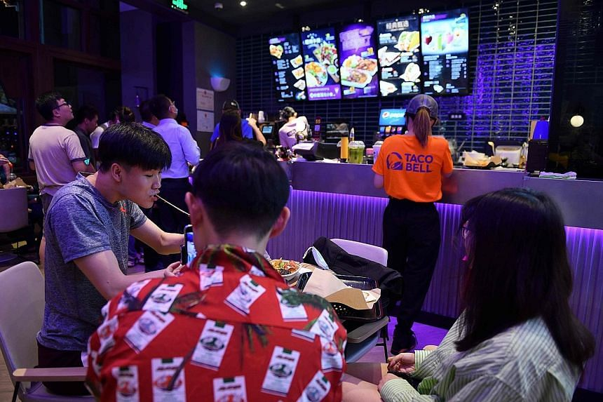Customers at a newly opened Taco Bell outlet in Beijing last week. Despite a delayed response and early missteps by the government, the recovery in China points to the success of its extreme tactics such as sweeping lockdowns. After months of travel