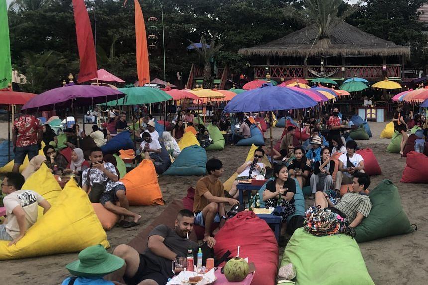 Domestic travellers at La Plancha, at Bali's Legian Beach.