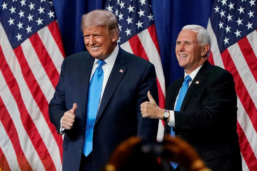 (From left) US President Donald Trump and Vice President Mike Pence give a thumbs up after speaking during the first day of the Republican National Convention, in Charlotte, North Carolina, on Aug 24, 2020.
