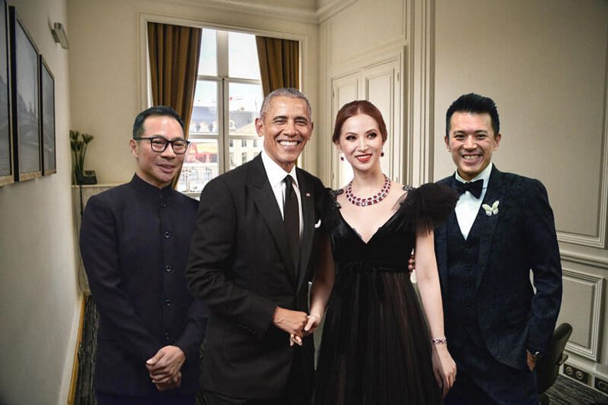 A publicity photo showing former US president Barack Obama in Paris with (from left) Mr Terence Loh, Ms Evangeline Shen and Mr Nelson Loh. BN Group said on Saturday it had been doctored.