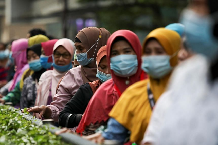 Passengers at a bus station in Kuala Lumpur on Aug 11, 2020.