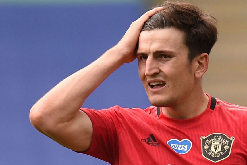 Manchester United's English defender Harry Maguire reacts during a match.