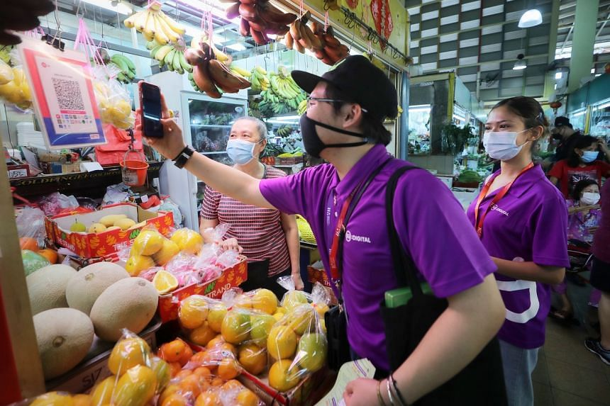 1,000 Digital Ambassadors have traversed Singapore to help stallholders and seniors learn how to use technological tools.