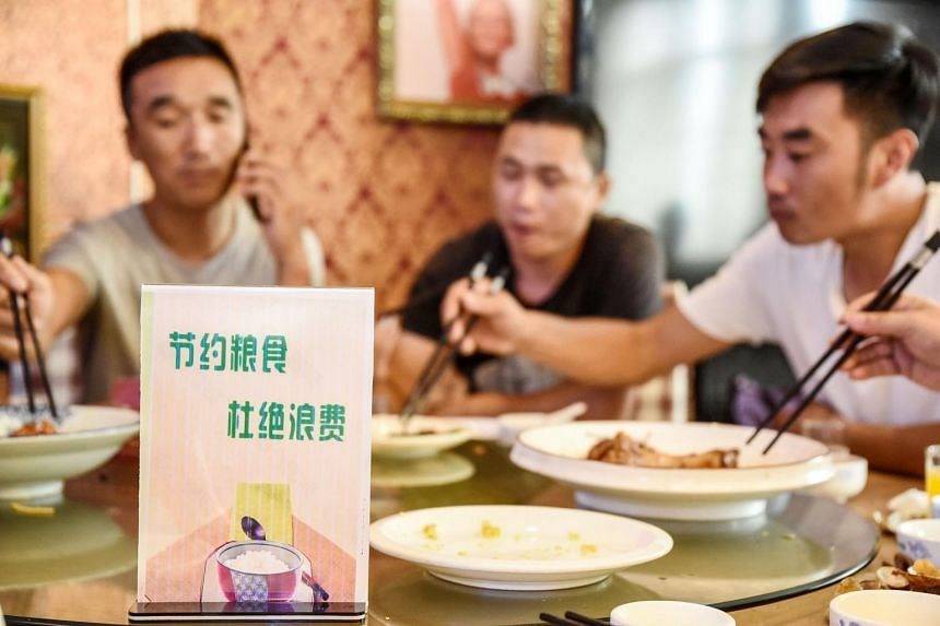 A sign encouraging people not to waste food at a restaurant in Handan, China, on Aug 13, 2020.
