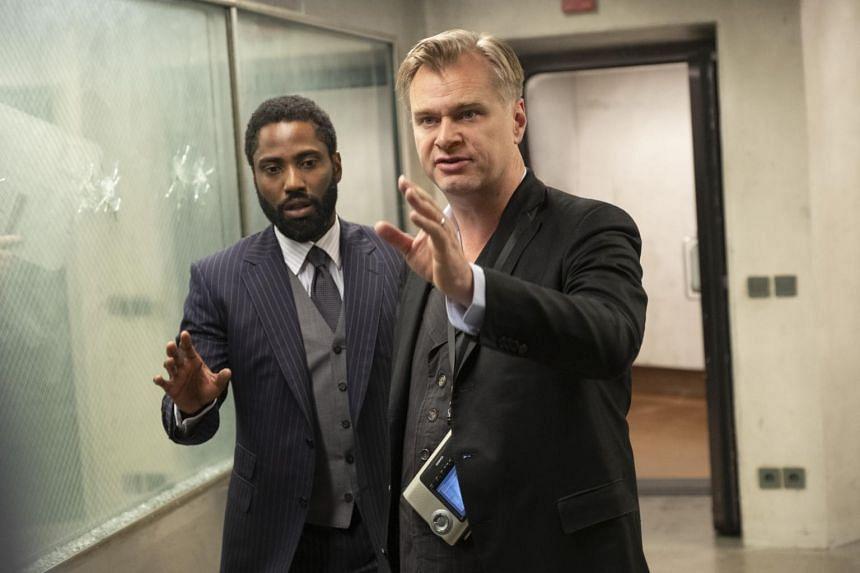 Christopher Nolan's Tenet stars John David Washington (left) Robert Pattinson and Elizabeth Debicki.