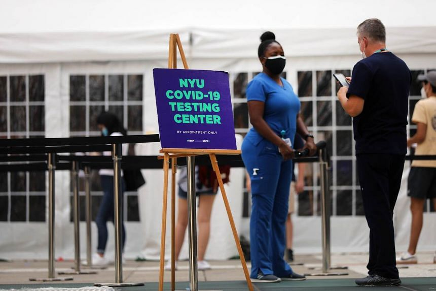 Students at New York University take a Covid-19 test outside its business school, on Aug 25, 2020.