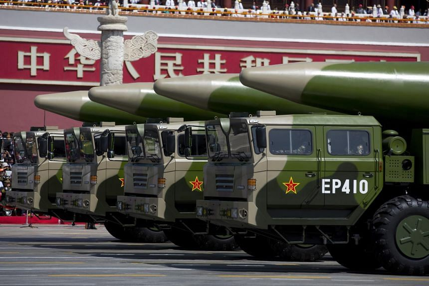 People's Liberation Army vehicles carrying DF-26 ballistic missiles driving through Tiananmen Square in Beijing on Sept 3, 2015. China fired two missiles into the South China Sea on Aug 26, 2020.