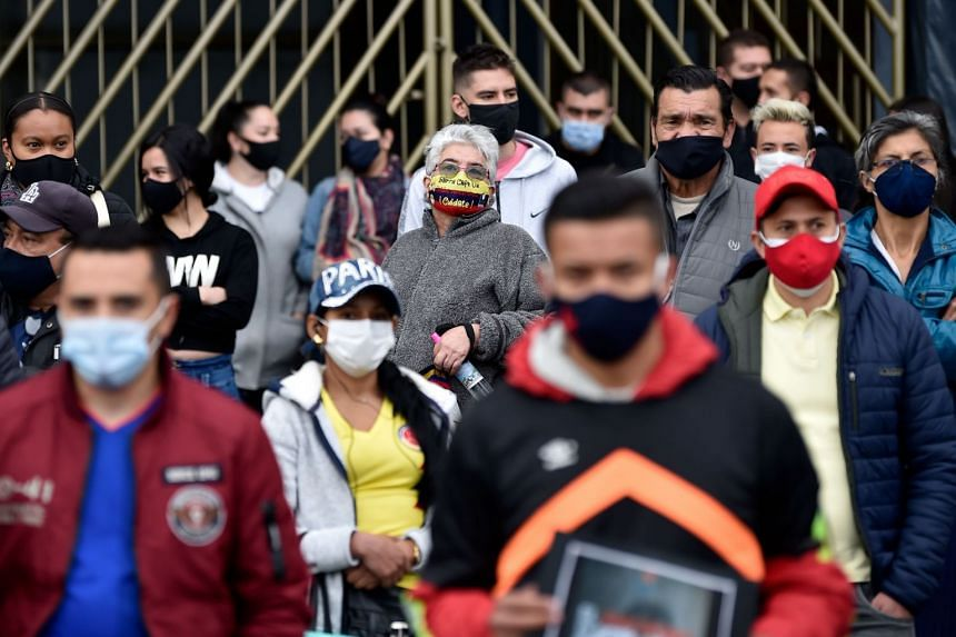 Merchants protest against new lockdowns imposed in Bogota, Colombia, on Aug 24, 2020.