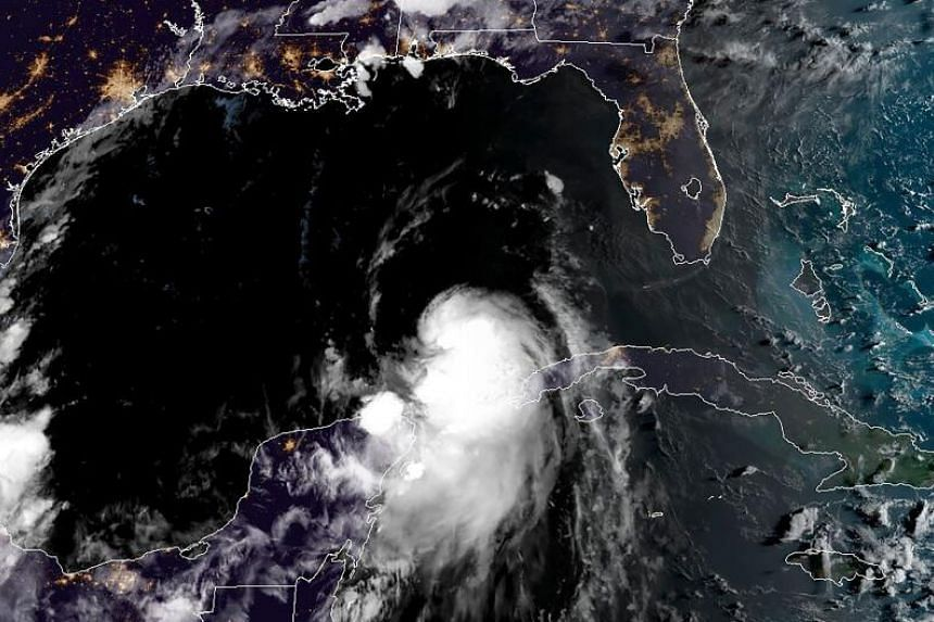 Tropical Storm Laura is seen moving across the Gulf of Mexico towards Louisiana on Aug 25 2020. Laura is set to become Category 4 storm with winds forecast to peak at 209kmh