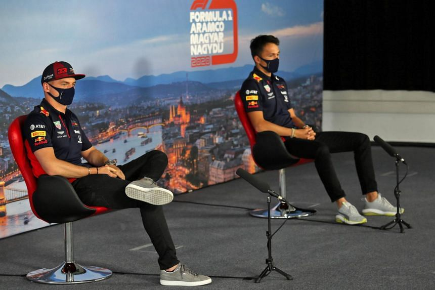 (From left) Max Verstappen and Alex Albon at a press conference for the Formula One Hungarian Grand Prix, on July 16, 2020.