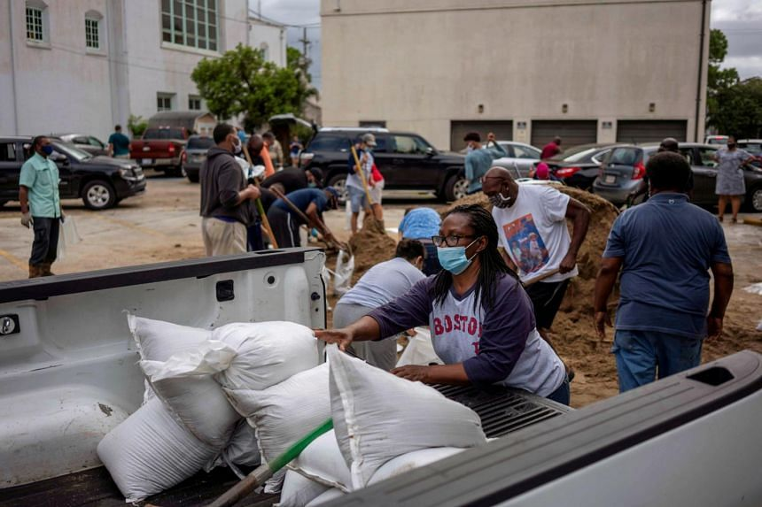 Residents filling sandbags at St Raymond Church, after warnings were issued for Hurricane Laura, in New Orleans, Louisiana on Aug 25, 2020.