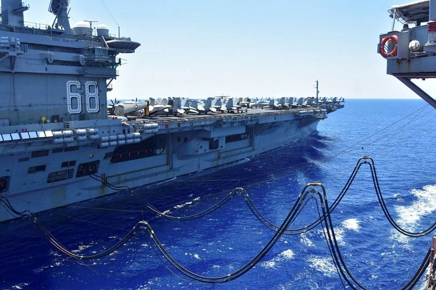 The US Navy carrier Nimitz receiving fuel from the USNS Tippecanoe in the South China Sea on July 7, 2020.