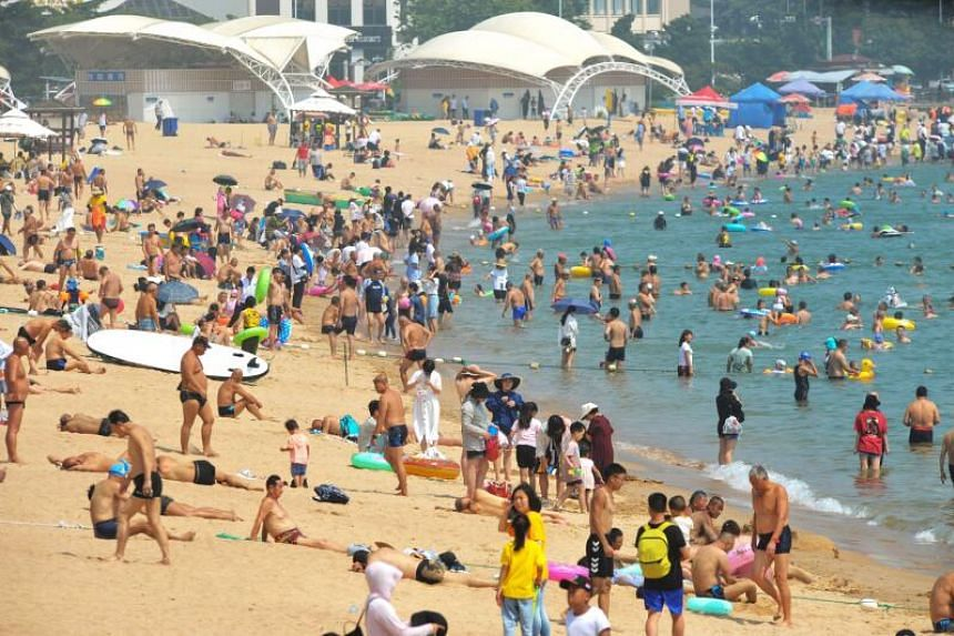 People cooling off on a beach amid high temperatures in Qingdao, China, on July 16, 2020.