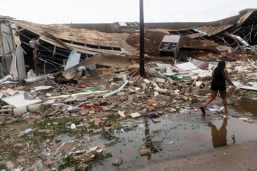 A resident walking past a destroyed building after the passing of Hurricane Laura in Lake Charles, Louisiana, on Aug 27, 2020.