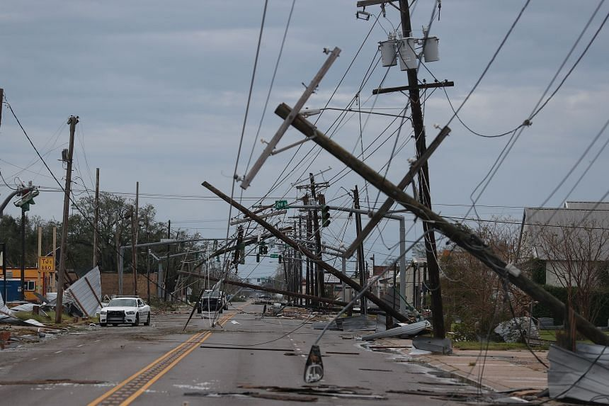 Debris and downed power lines are seen on a street after Hurricane Laura hit the area, in Lake Charles, Louisiana, on Aug 27, 2020.