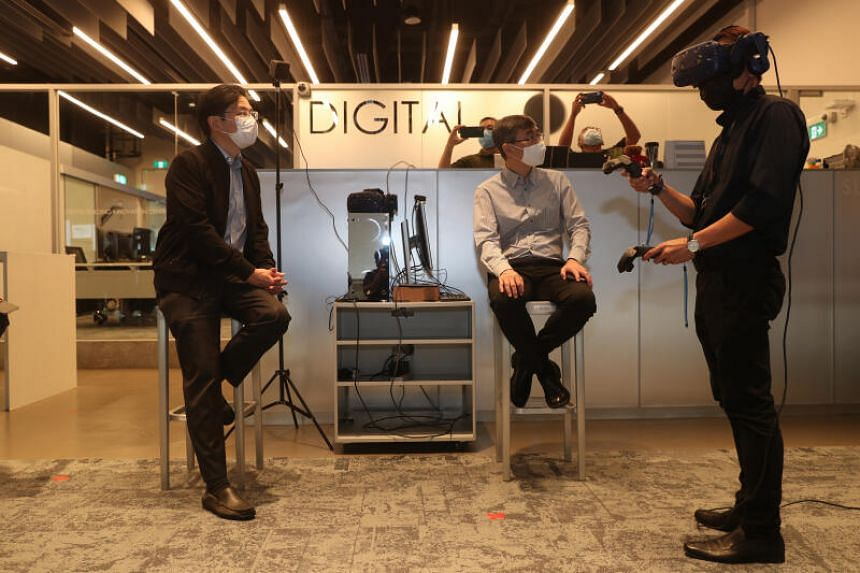 Education Minister Lawrence Wong (left) observing an AR/VR demonstration at Singapore Polytechnic on Aug 27, 2020.