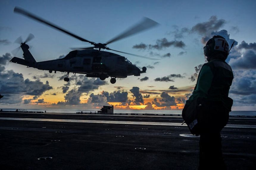 A Sea Hawk helicopter launches during flight operations in South China Sea, on July 17, 2020.