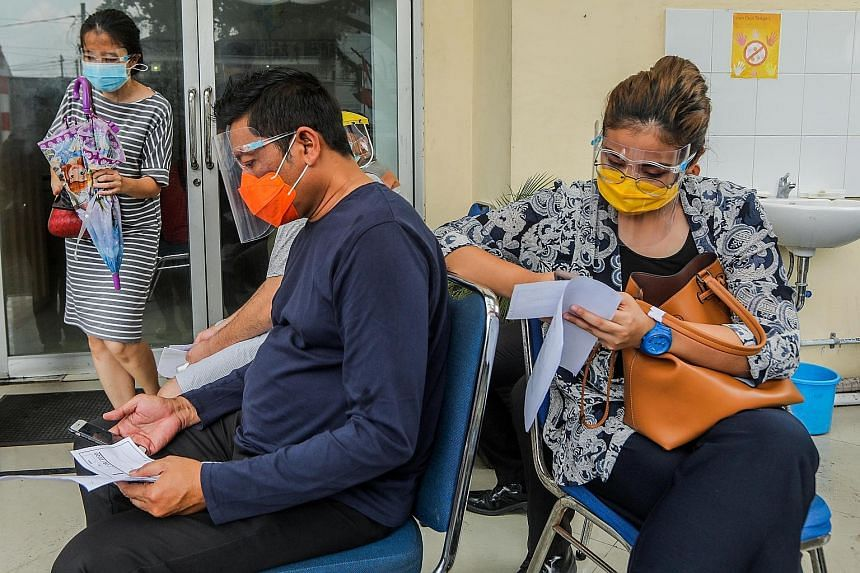 People waiting to take a Covid-19 swab test in Medan, Indonesia, yesterday. Noting that men account for about 60 per cent of deaths from Covid-19 globally, a new study examined the differences in male and female immune responses.