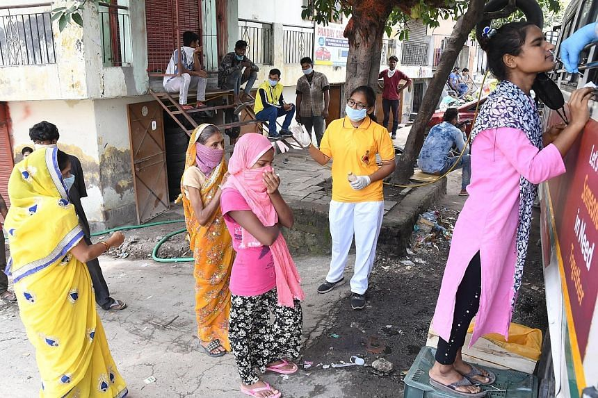 People queueing up for a Covid-19 swab test in New Delhi yesterday. India confirmed 75,760 new infections yesterday, taking its total coronavirus tally to over 3.3 million cases. PHOTO: EPA-EFE