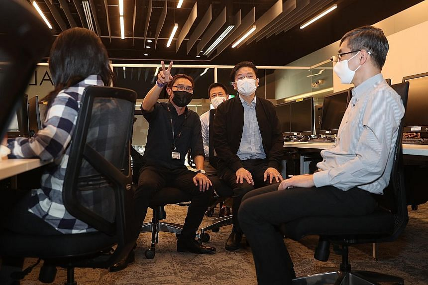 Education Minister Lawrence Wong (second from right) being briefed by Singapore Polytechnic senior lecturer Chris Ho while observing a class for one of the new courses yesterday. Also present were SkillsFuture Singapore chief executive Ong Tze Ch'in