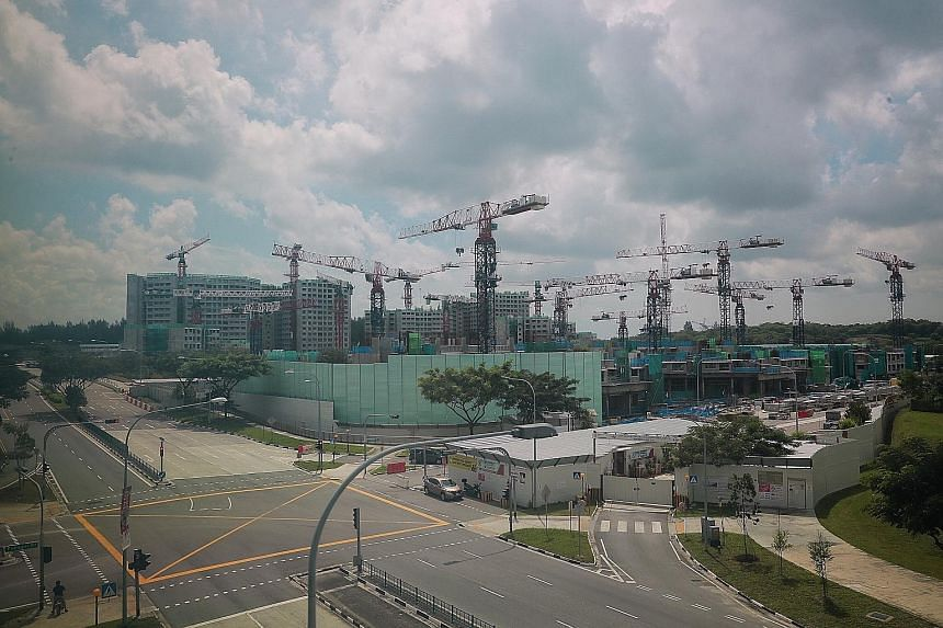 The construction site of the Waterway Sunrise II project (front) in Punggol yesterday. Launched in February 2017, the project has 1,014 units in seven blocks and is currently about 45 per cent completed. ST PHOTO: JASON QUAH