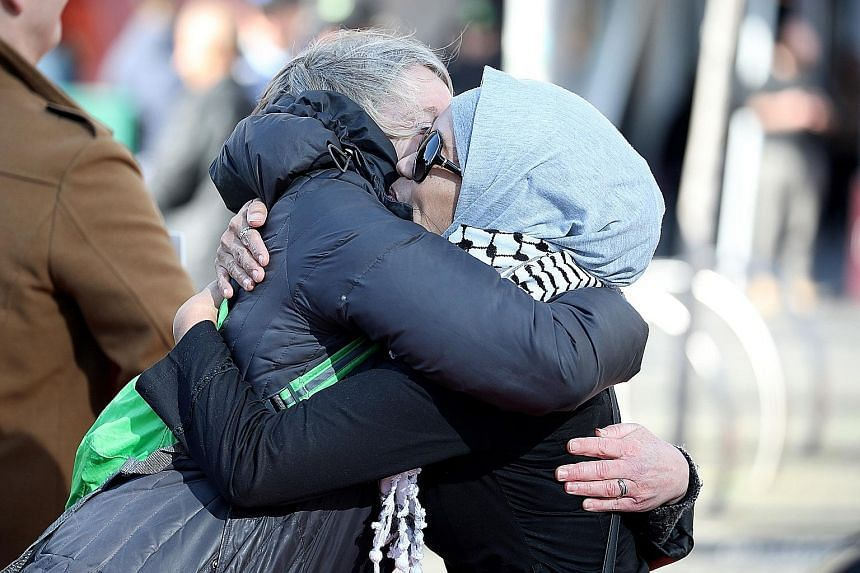 Survivors and members of the public reacting after the sentencing of Australian white supremacist Brenton Tarrant in Christchurch yesterday. The 29-year-old admitted to 51 charges of murder, 40 counts of attempted murder and one charge of committing