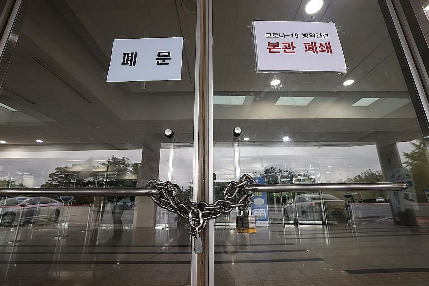 The locked entrance to the main building of the National Assembly. All parliamentary activities were suspended from yesterday.