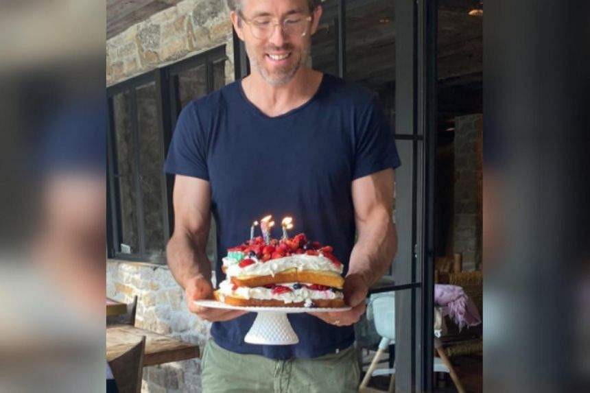 Blake Lively shared a series of photos of husband Ryan Reynolds carrying a cake, zooming in on the 43-year-old's left bicep.