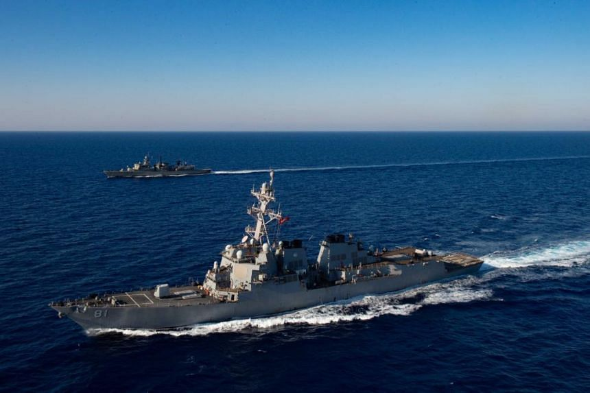 US guided missile destroyer USS Mustin carried out a freedom of navigation operation near the Paracel islands.