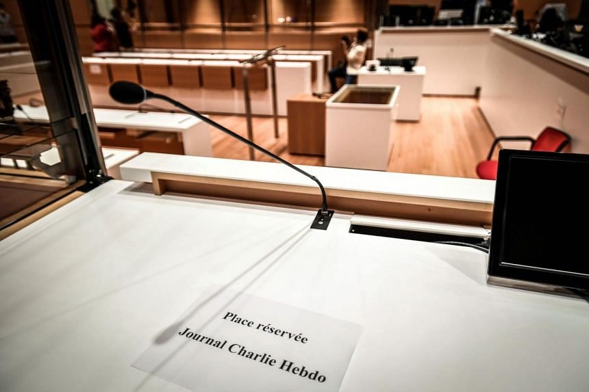 """A sign reading """"Reserved for Charlie Hebdo newspaper"""" in the courtroom prior to the opening of the trial, on Aug 27, 2020."""