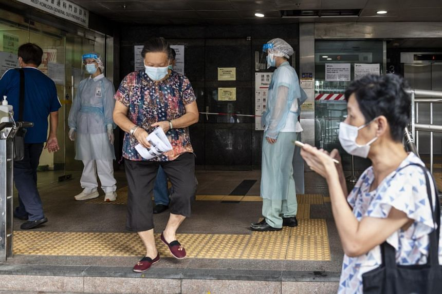 Residents receive free Covid-19 test kits at Cheung Sha Wan Government Offices in Hong Kong, on Aug 20, 2020.