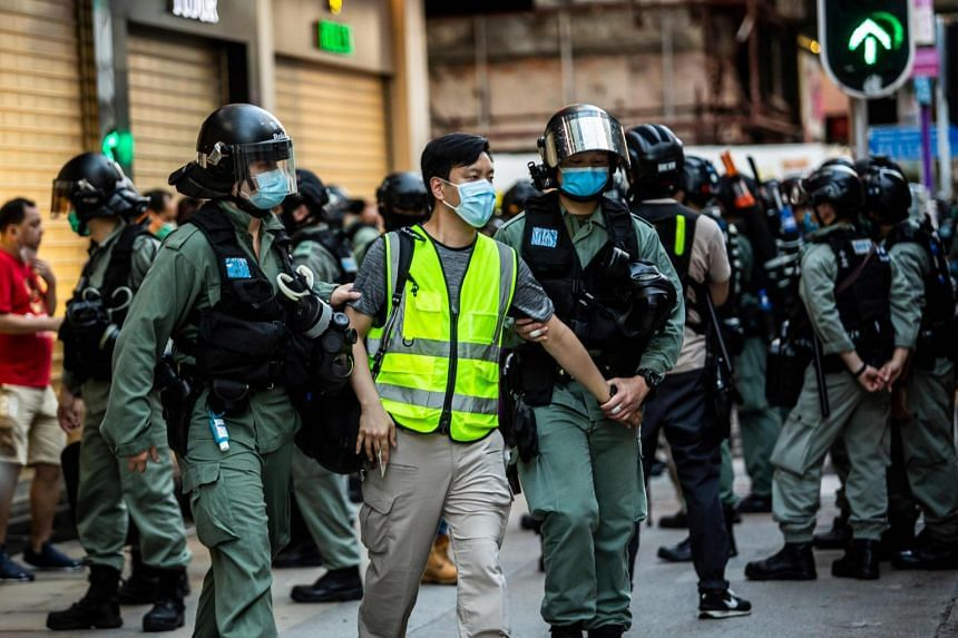 A photo taken on June 28, 2020, shows police arresting a man during a protest against China's planned national security law in Hong Kong.