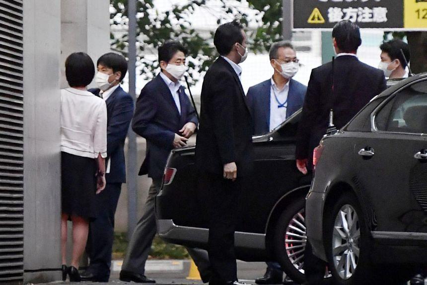 Japan's Prime Minister Shinzo Abe leaving Keio University Hospital in Tokyo on Aug 17, 2020.