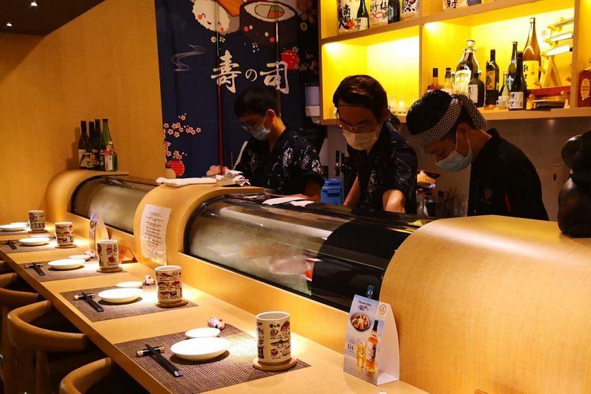 Staff working at Kiyoshi Sushi Bar.