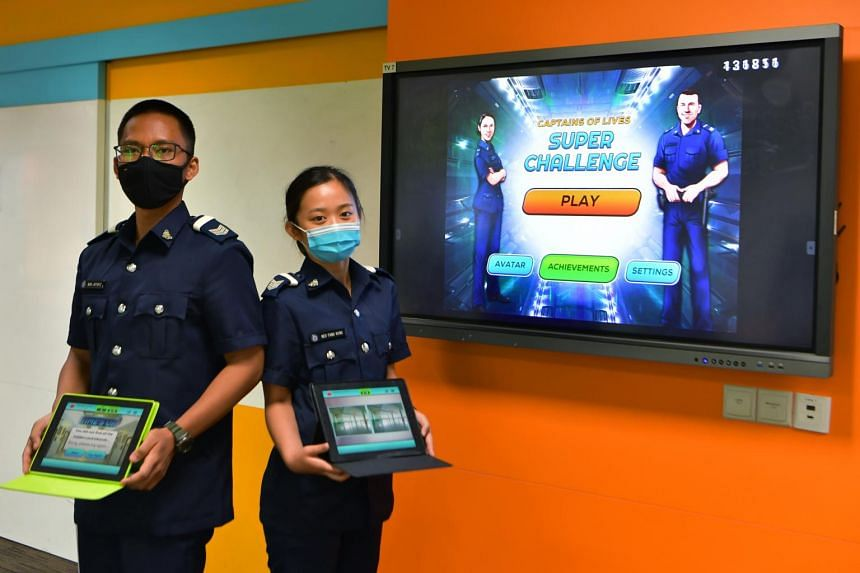 (From left) Sergeant Muhammad Jaffariz Siddiq Ahmad Azeri and Sergeant Neo Fang Ning using the Mobile Interactive Training Application during their Prison Officer Course.