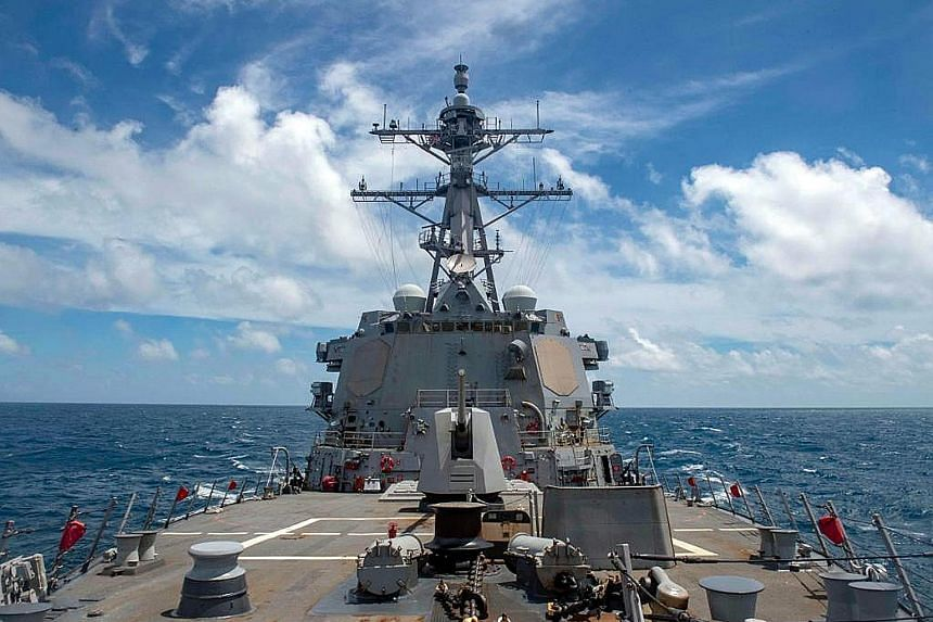 The comments against the United States by a Chinese Foreign Ministry spokesman yesterday came after the US' guided missile destroyer USS Mustin (above) carried out a freedom of navigation operation near the Paracel Islands, where the People's Liberat