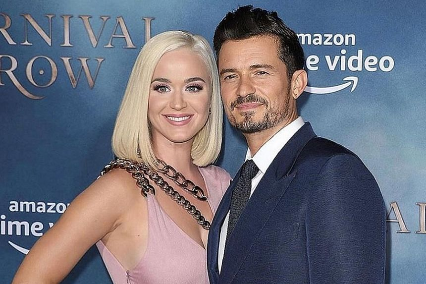 Singer Katy Perry and actor Orlando Bloom (both above) announced the birth of Daisy through Unicef's Instagram page with a photo of the couple's hands holding their daughter's.