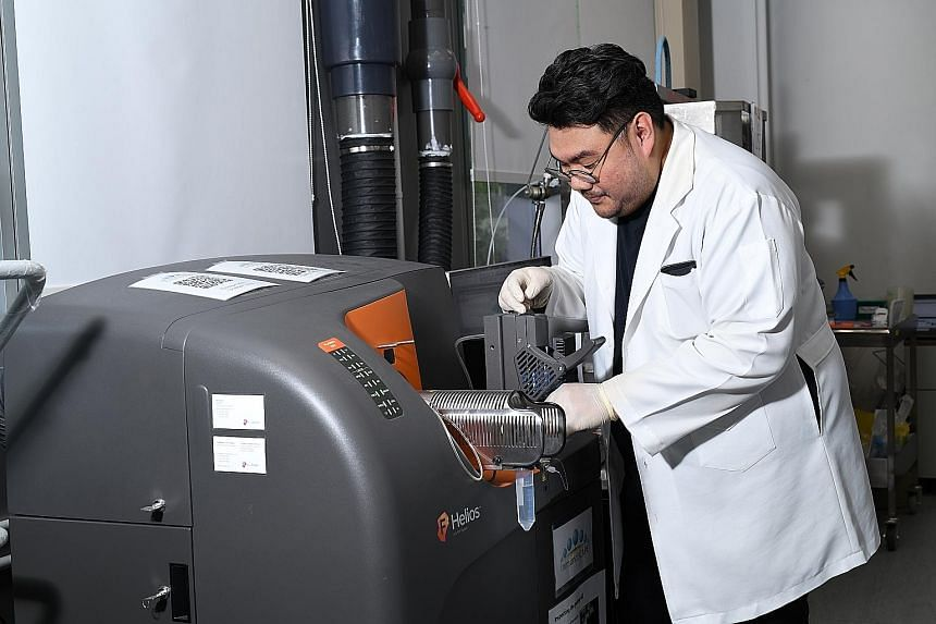 Mr Faris Kairi, a senior research officer at ImmunoScape, working on a mass cytometry machine to process human samples for the firm's Covid-19 project. As more studies into the T cell response to Sars-CoV-2 have emerged, scientists have begun to reco