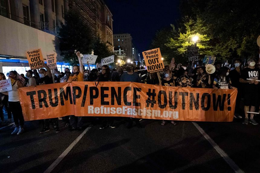 Demonstrators marching outside the White House on Thursday to protest against US President Donald Trump's acceptance of the Republican presidential nomination. Yesterday, people were set to march in Washington against racism and police brutality.