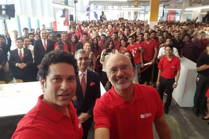 DBS India employees, alongside chief executive officer Piyush Gupta, celebrate the opening of a new office in Mumbai on Sept 5, 2017.