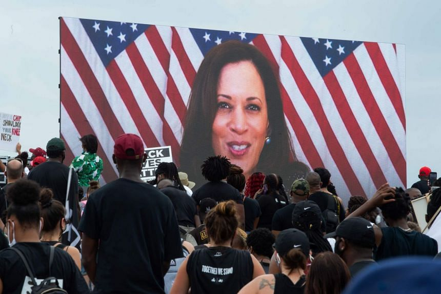Demoonstrators listen as Democratic vice-presidential nominee Kamala Harris addresses the protest remotely