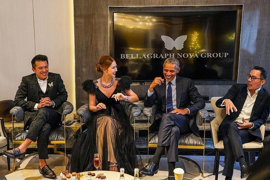 Above: This image of former United States president Barack Obama with (from left) Mr Nelson Loh, Ms Evangeline Shen and Mr Terence Loh was released by the Bellagraph Nova Group when it announced its Newcastle bid on Aug 15. It later emerged that the