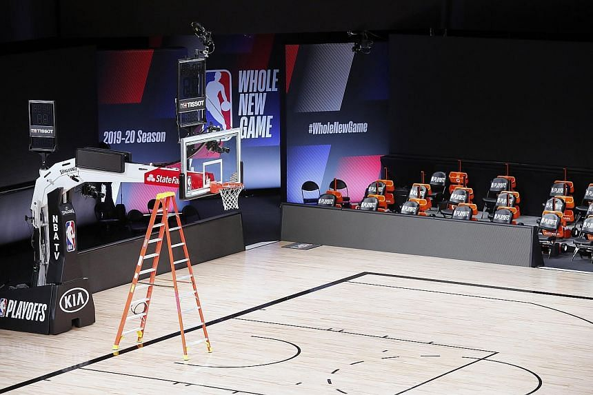 An empty arena in Florida where the NBA play-offs were being held. NBA players had staged a work stoppage in response to the police shooting of Mr Jacob Blake, a black man, in Kenosha, Wisconsin, last weekend.