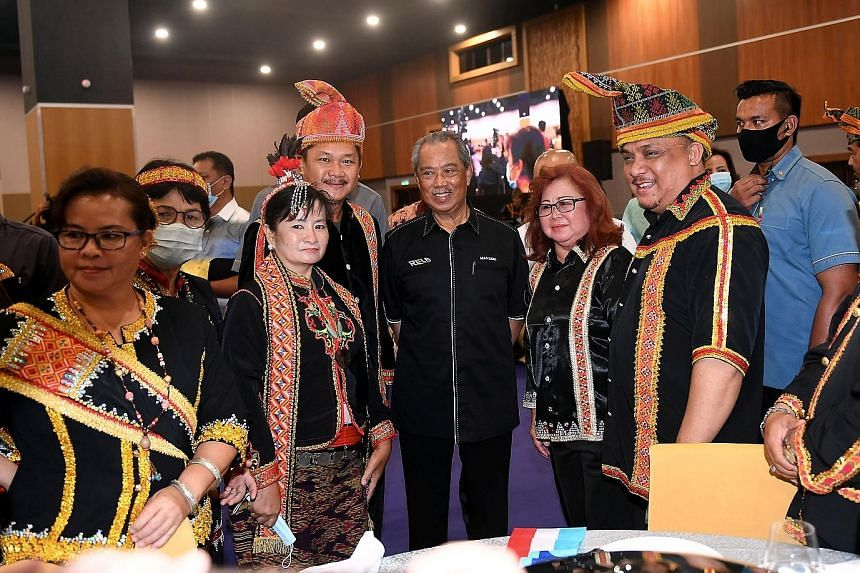 Malaysian Prime Minister Muhyiddin Yassin (centre) with members of the Bajau ethnic community in Sabah yesterday. He is visiting Sabah ahead of polls next month to elect a new government for the state.
