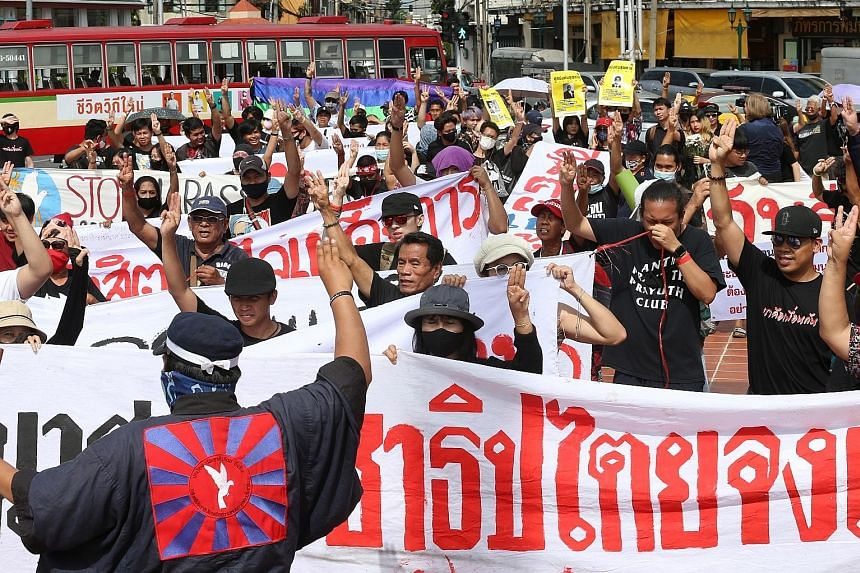 Students and pro-democracy activists flashing the three-finger salute - a trademark of the nationwide youth-driven protests - as they marched in Bangkok on Friday. Protesters have mustered both flash mobs and hours-long extravaganzas, but stayed away