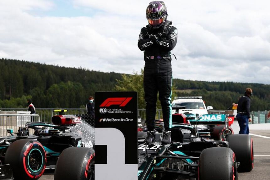 Lewis Hamilton gestures in homage to late US actor Chadwick Boseman.