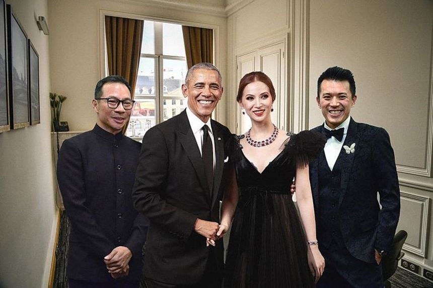 A publicity picture distributed by Bellagraph Nova Group that purports to show founders (from left) Terence Loh, Evangeline Shen and Nelson Loh meeting Mr Barack Obama in their Paris office.