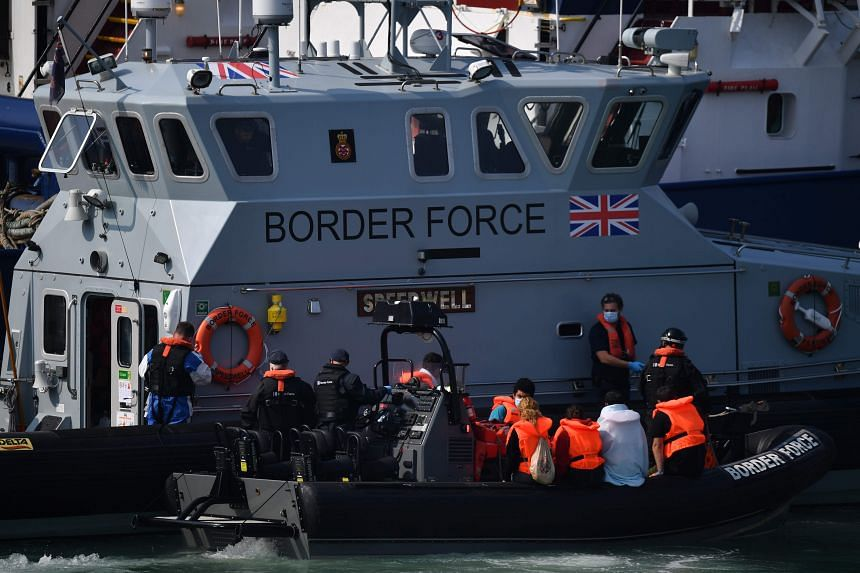 UK Border Force officials transfer migrants intercepted from France to Dover, on Aug 13, 2020.