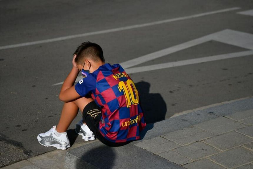 A young fan wearing the jersey of Barcelona's Lionel Messi sitting outside the Ciutat Esportiva, where players were gathering to take a Covid-19 test, on Aug 30, 2020.