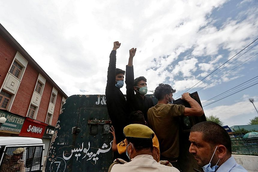Kashmiri Shi'ite Muslims shouting slogans as they were detained by police during a protest yesterday. The Indian authorities had reimposed a ban on religious gatherings last Thursday after clashes with Shi'ite Muslims wanting to stage traditional pro